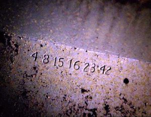 The Lost Numbers (4, 8, 15, 16, 23, 42) printed on the entrance to The Hatch (image from lostpedia.wikia.com)