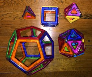 A set of five platonic solids, made using magnetic clear coloured plastic pieces