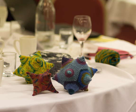 Knitted icosahedra on a table; Photo by Steve Kirkby (steve.kirk.by)