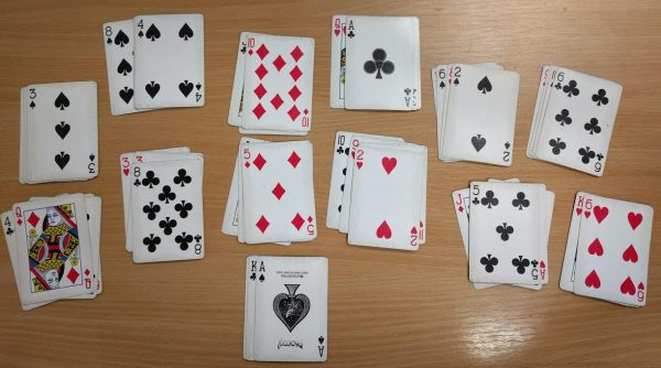 A deck of cards arranged in 13 piles of 4 cards