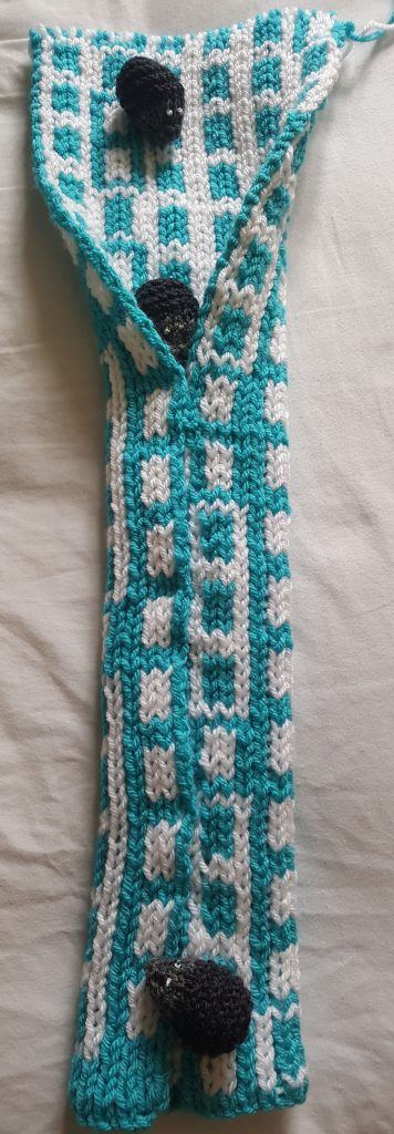 Knitted scarf rolled into a cylinder, showing the number line spiralling around to show distribution of primes mod 6