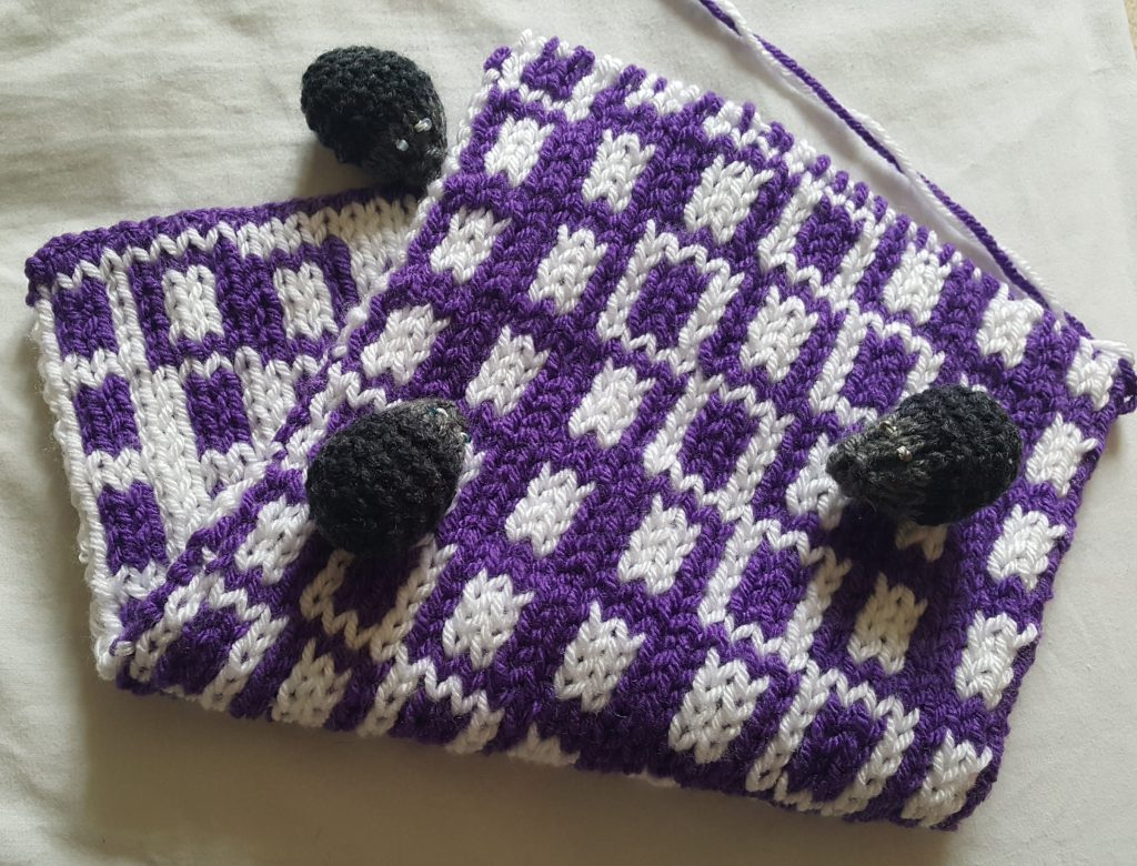 Folded scarf showing front and back of design