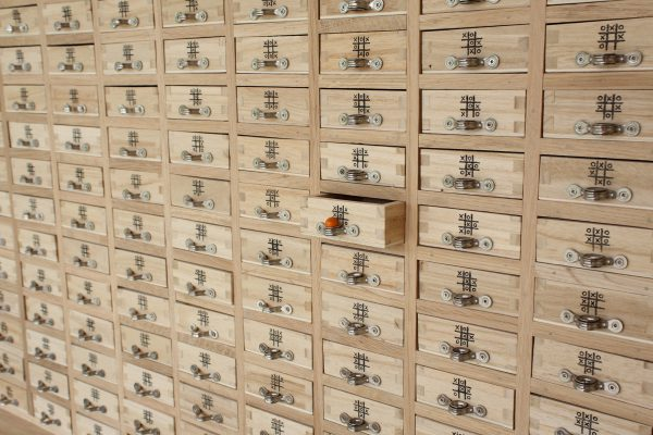 Absolutely loads of drawers in a grid. Each drawer has a noughts and crosses position marked on it