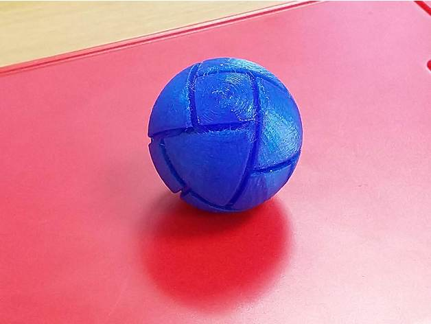 3D printed sphere with edges cut out of it, making squares and triangles which meet halfway along the edges