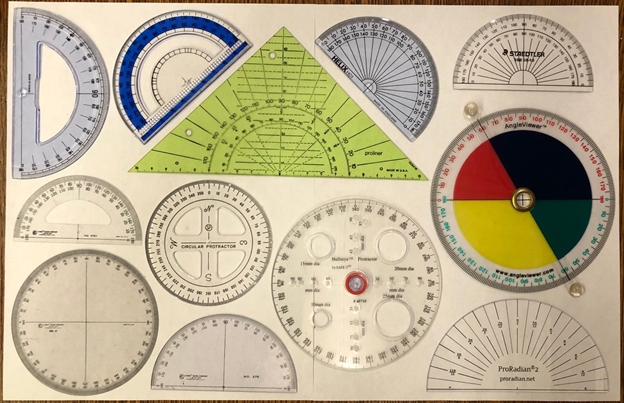 Lots of protractors arranged on a sheet of paper