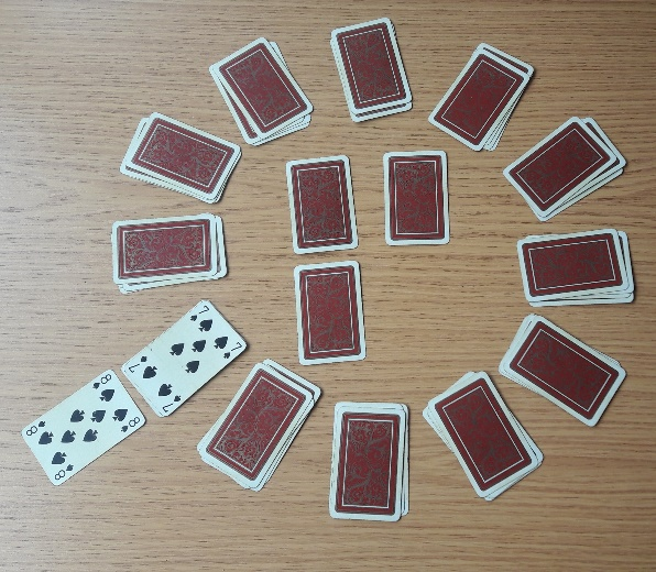 After one move, the 8 is next to the 8 position on the clock, and that pile has been turned over to reveal the 7 of spades