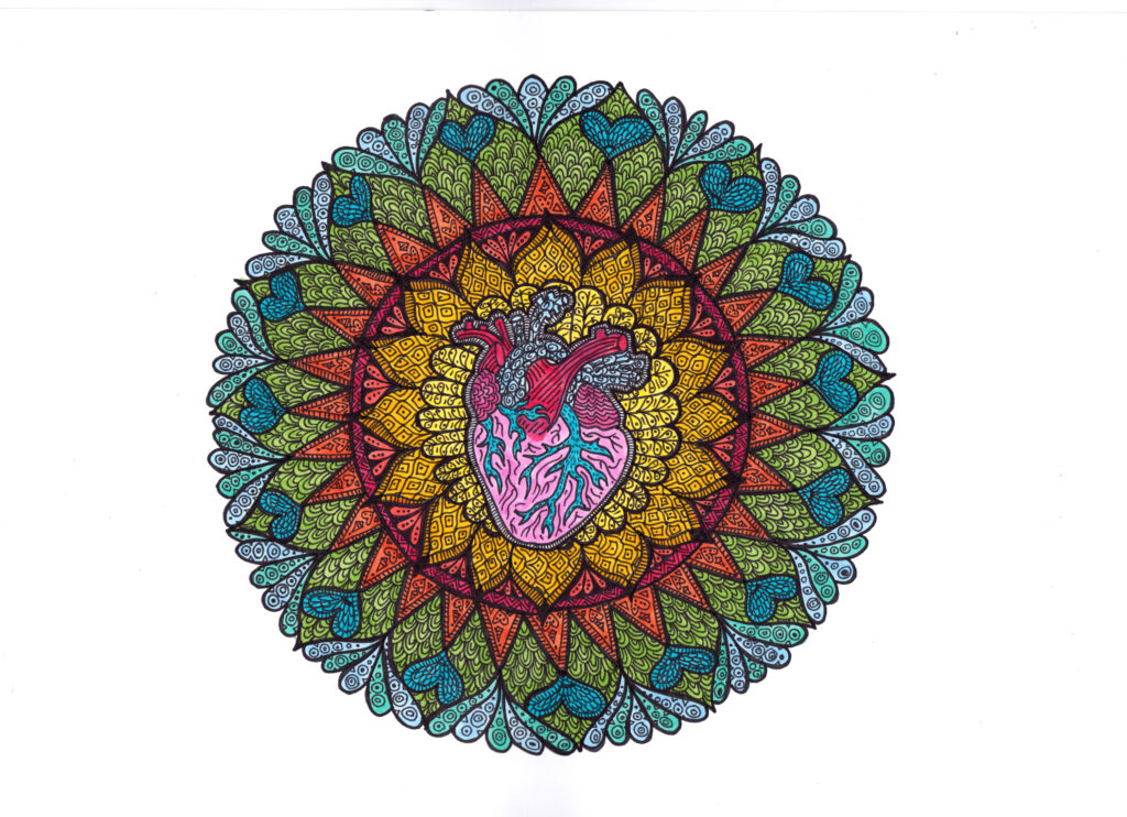 Mandala patterned circle with an anatomical heart at the centre