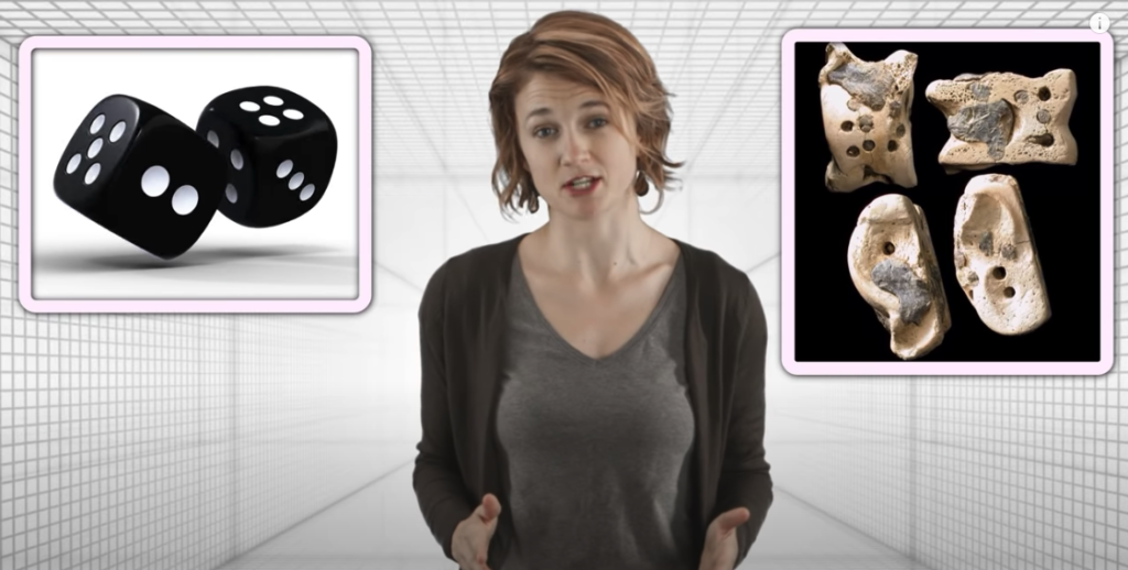 Screenshot of PBS Infinite Series' Kelsey Houston-Edwards presenting the history of probability video; still shows dice and ancient bone dice