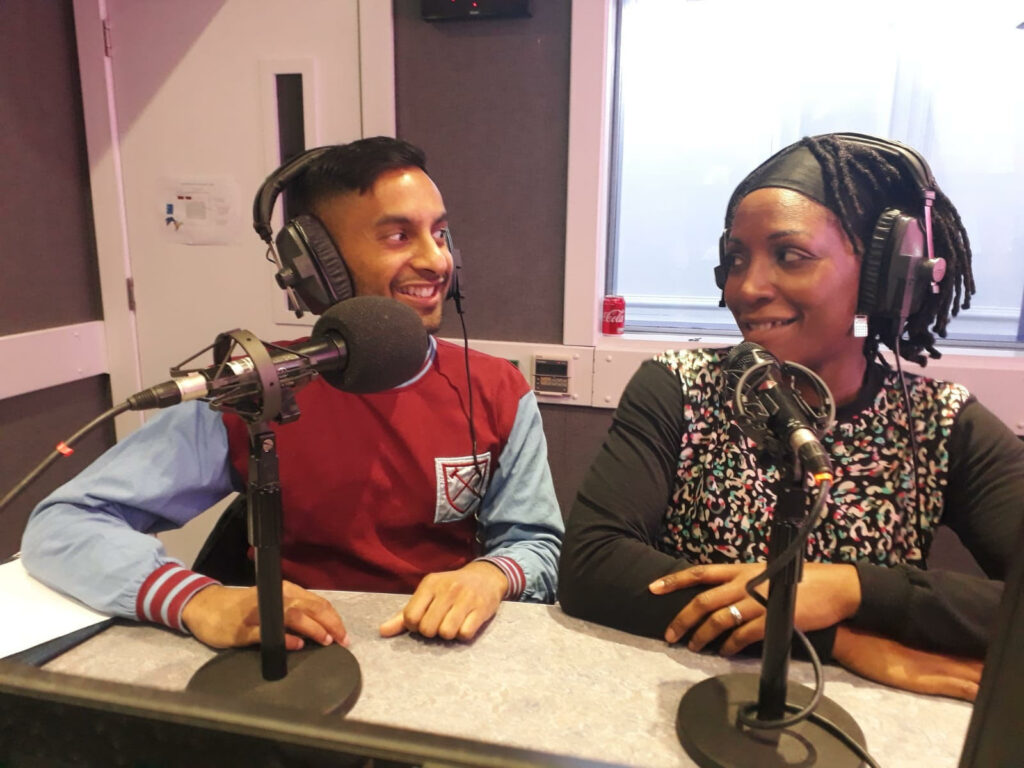 Bobby Seagull and Susan-Louise Okerere, sitting behind microphones in a recording studio