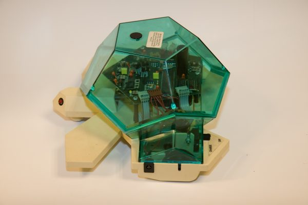 A robot turtle. Its shell is clear plastic, through which you can see lots of electronics and a pen holder.