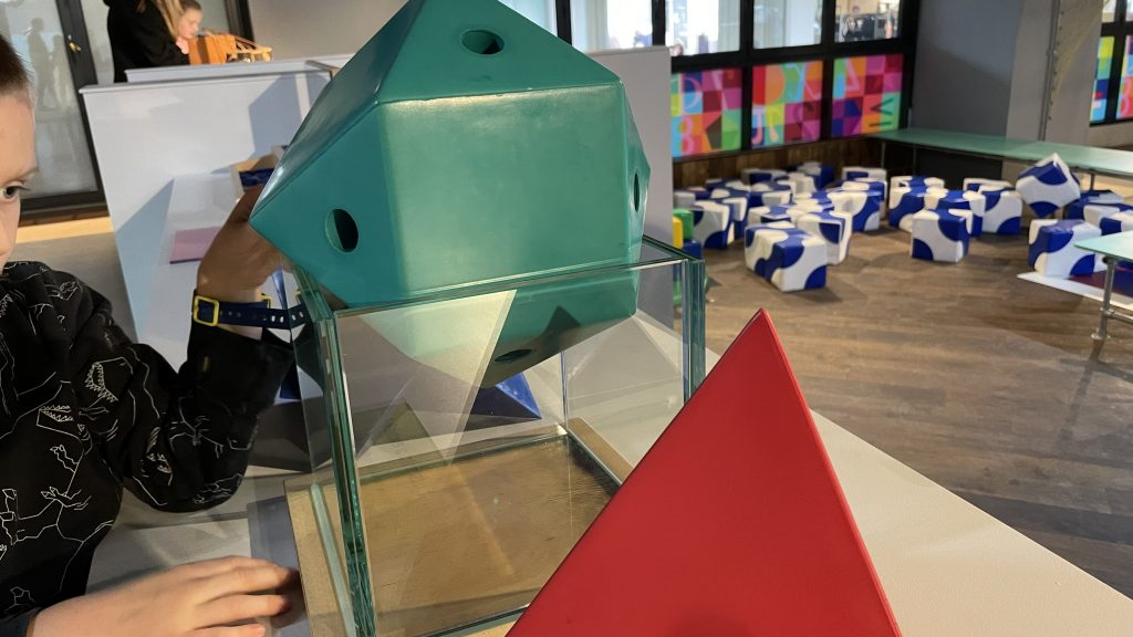 Polyhedra attempting to fit inside transparent cube