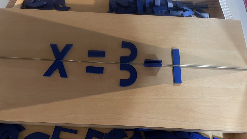 Mirror half-letters used to form an approximation of x = 3 - 1.